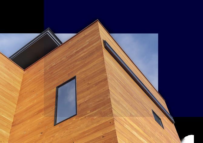 Fasade forsidebilde, hus med liggende kledning i gylden trefarge og moderne vinduer