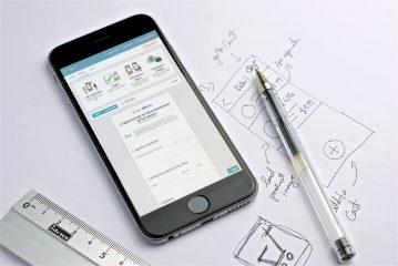 En mobil med landingssiden til digital håndverkerkontrakt