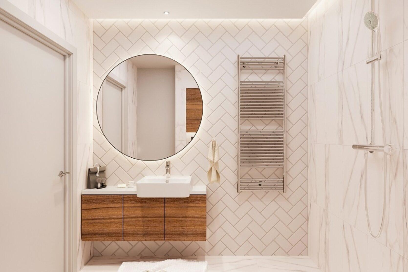 Baderom med hvite fliser på veggene, stort rundt speil over vask og dusj montert på veggen.